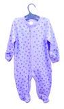 Attaccatura delle merci del bambino Pijama dei cursori del cosmonauta del corpo dell'abbigliamento del ` s dei bambini su un ganc Immagine Stock Libera da Diritti
