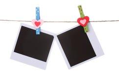 Attaccatura di carta della foto sul clothesline Fotografia Stock