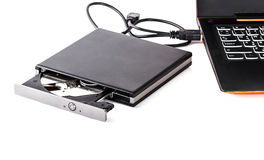 Attaccatura rewritable del compact disc sul taccuino del computer fotografia stock