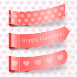 Attach valentine ribbons. Royalty Free Stock Photography