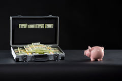 Attache full of money. Stock Images