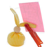 Attached sheets reminders candle eggs  hare   decorations. Pre-Easter theme homemade toy bunny candles ovoid yellow sheet of paper for recording not to forget Royalty Free Stock Images