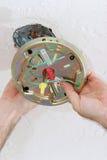 attaching box ceiling fan plate to στοκ φωτογραφία