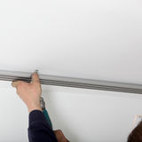 Attaching Metal Track To Ceiling Stock Photography