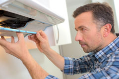 Attaching new extractor fan Stock Images