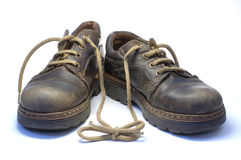Attachment. Two children's old shoes with shoelaces Royalty Free Stock Images