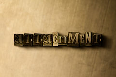 ATTACHMENT - close-up of grungy vintage typeset word on metal backdrop Royalty Free Stock Images
