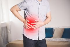 Attack of appendicitis, man with abdominal pain suffering at home royalty free stock photography