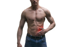 Attack of appendicitis, pain in left side of muscular male body, isolated on white background. With red dot royalty free stock photography
