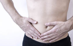 Attack of appendicitis. Pain in the right side. . in the the abdomen, close-up image. stock photo