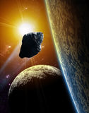 Attack of the asteroid on the planet in the universe. Stock Photos