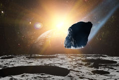 Attack of the asteroid on the planet in the universe. Stock Images