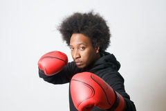 Attack boxing. Black Boxer with red boxing gloves in attack Royalty Free Stock Photo