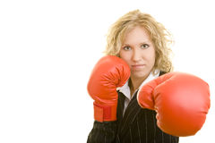 Attack with boxing gloves. Blonde business woman with red boxing gloves royalty free stock photography