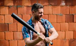 Attack concept. Bully guy carry cudgel brick wall background. Power and strength. Feel my strength. Man unshaven face royalty free stock images