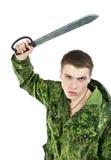 Attack för militär man med kniven Arkivbild