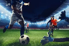 Football scene with competing football players at the stadium. Attack game action during a football game at the stadium royalty free stock photo