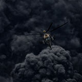 Attack helicopter against the background of smoke. After the mission. Modern russian attack helicopter with with weapons Stock Image