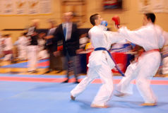 Attack in karate combat. Attack and defence in karate combat Stock Photos