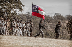 Attack From the Ridgeline. Confederates move down the ridgeline  during a  Civil War Reenactment at Anderson, California Stock Images