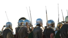Attack row of the ancient roman soldiers in helmets with spears stock video footage