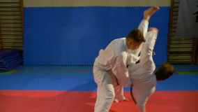 Attack and self defense techniques practiced during karate training stock footage
