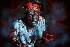 Attacked by zombie. Bloody zombie man with brains out. Horror. Halloween Stock Photos
