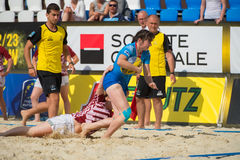 The attacker could not be kept. MOSCOW, RUSSIA - JULY 22-23, 2017: Rugby players in action at the on European Beach Fives Rugby Championship 2017 in the match royalty free stock photos