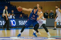 Attacker and defender. MOSCOW, RUSSIA - OCTOBER 29, 2018: Mikhail Kulagin 30 in a basketball game CSKA vs Parma Perm on the regular championship of the VTB royalty free stock photography