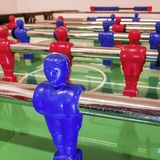 Attacker of a red and blue football table in a game room. In a games room of many residences or Italian hotels you will find table tennis, table football, and royalty free stock photo