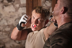 Attacker Throws Jabs at Opponent. Aggressive fighter throwing jab punches at opponent stock photography