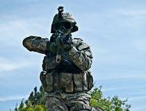 Attacking. US soldier shooting his gun moving towards the camera Royalty Free Stock Photo