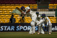 Attacking batting shot. Attacking shot by a batsman in cricket stock photography