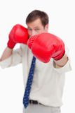 Attacking businessman with boxing gloves Royalty Free Stock Photo