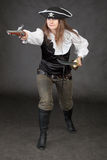 Attacking pirate armed with sabre and pistole Royalty Free Stock Image