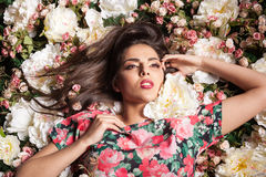 Attactive Seductive sensual woman lying on flowers Stock Photos