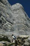 Attainable goal. Hiker/climber contemplating a high cliff stock photos