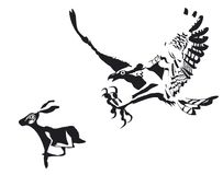 Attak di Eagle un coniglio per mangiare Fotografie Stock Libere da Diritti