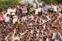 Attari, Punjab, India. ATTARI, INDIA - OCTOBER 18: Indian celebrating at the Indian - Pakistani border during the border closing ceremony at October 18, 2012 in Royalty Free Stock Image