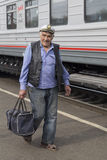 Attendant in the railway station,russian federation. Attendant in the railway station is taken in russian federation Royalty Free Stock Photo