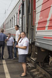 Attendant in the railway station,russian federation. Attendant in the railway station is taken in russian federation Royalty Free Stock Photography