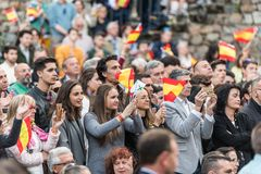 Attendants with flags of Spain to the meeting of Vox, the far right Spanish party, with Santiago Abascal. Caceres, Extremadura, Spain - May  18, 2019: Attendants royalty free stock photos