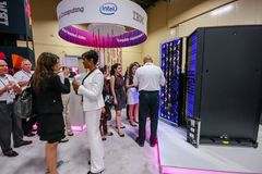 Attendees listen stand-attendant at Intel booth of exhibition. LAS VEGAS, NV - JUNE 10, 2013: Attendees listen stand-attendant at Intel booth of exhibition in Stock Photography