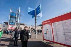Attendees look at information board at CeBIT. HANNOVER, GERMANY - MARCH 14, 2016: Attendees look at information board at CeBIT information technology trade show Royalty Free Stock Photography