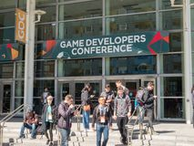 Attendees stream out of the Game Developers Conference GDC 2018. SAN FRANCISCO, CA - MARCH 18, 2018: Attendees stream out of the Game Developers Conference GDC Stock Photo