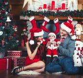 Attente de famille Noël Photographie stock