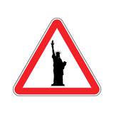 Attention America. Statue of Liberty on red triangle. Road sign Royalty Free Stock Image