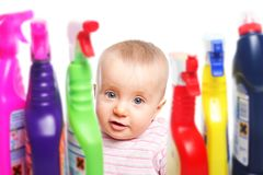 Attention: Baby wants to play with cleaner Stock Photos