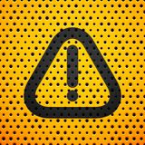 Attention black sign on yellow metal texture with Stock Photography