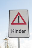 Attention children sign in german language. At the street Royalty Free Stock Image